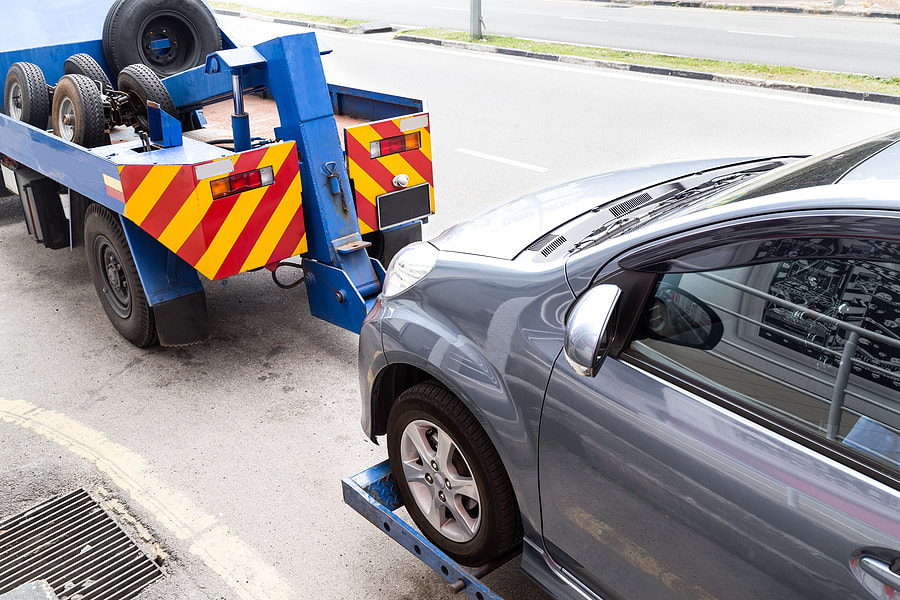 a car being pull by the towing truck